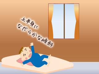 赤ちゃんの上半身をタオルに載せて寝かせるを