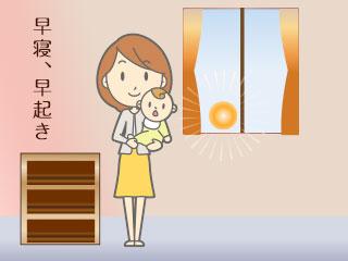 朝日が射す部屋で赤ちゃんを抱く母親
