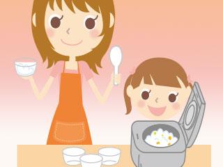 炊飯器で料理を作る親子