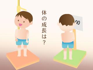 身長と体重を量る子供