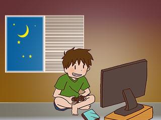 夜更かししてテレビゲームをする子供
