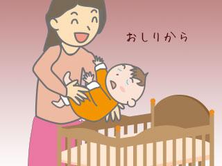 赤ちゃんをお尻からベッドにつける母親