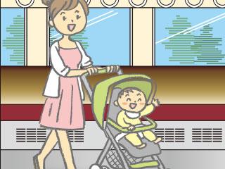空いた電車内をベビーカーを押す母親