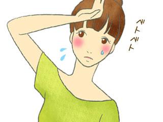 顔に汗をかいてる女性