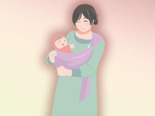 抱っこ紐で赤ちゃんを抱く母親