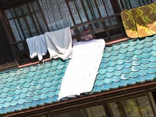 おねしょした子供の布団を干している家庭