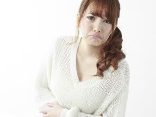 生理痛に悩まされる産後の女性