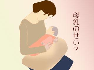 赤ちゃんを授乳クッションにのせる母親