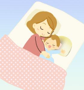 ドーナツ枕で寝る赤ちゃん