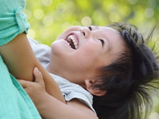 不機嫌も吹き飛ぶ子供の笑顔