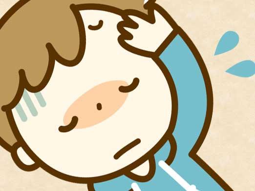 熱が出て頭を押さえている男の子のイラスト
