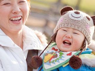 冬服を着た赤ちゃん