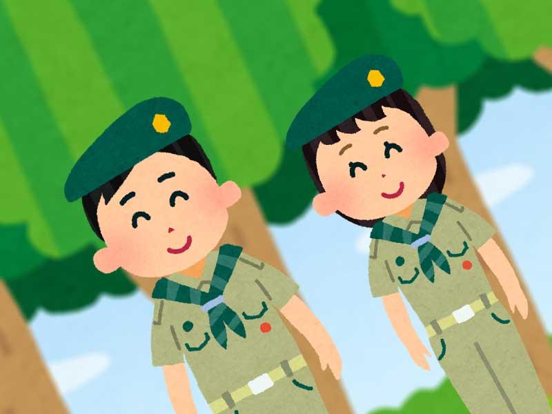 森にいるボーイスカウトの男の子と女の子