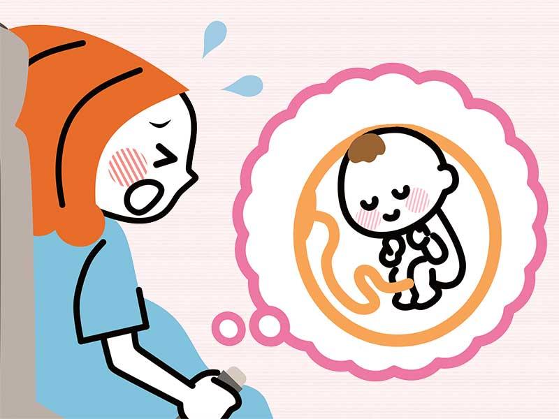 逆子で苦しんでる妊婦のイラスト