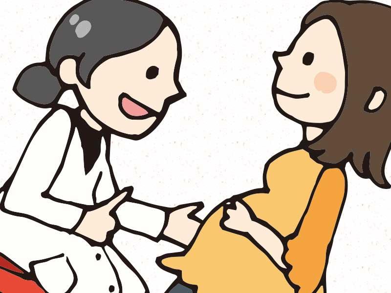 産婦人科で診察を受ける妊婦のイラスト