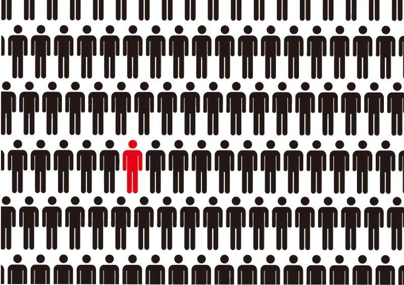 沢山黒い人の中に赤い人が一人