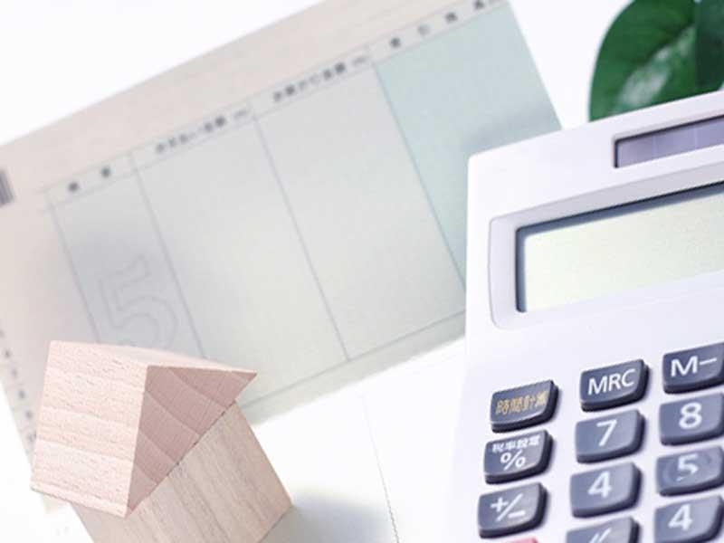 預金通帳と電卓