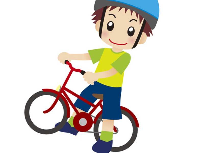 ランニングバイクにまたがってる子供のイラスト