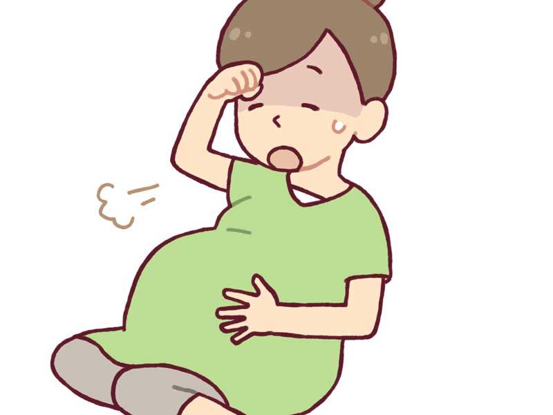 めまいがして辛そうな妊婦さんのイラスト