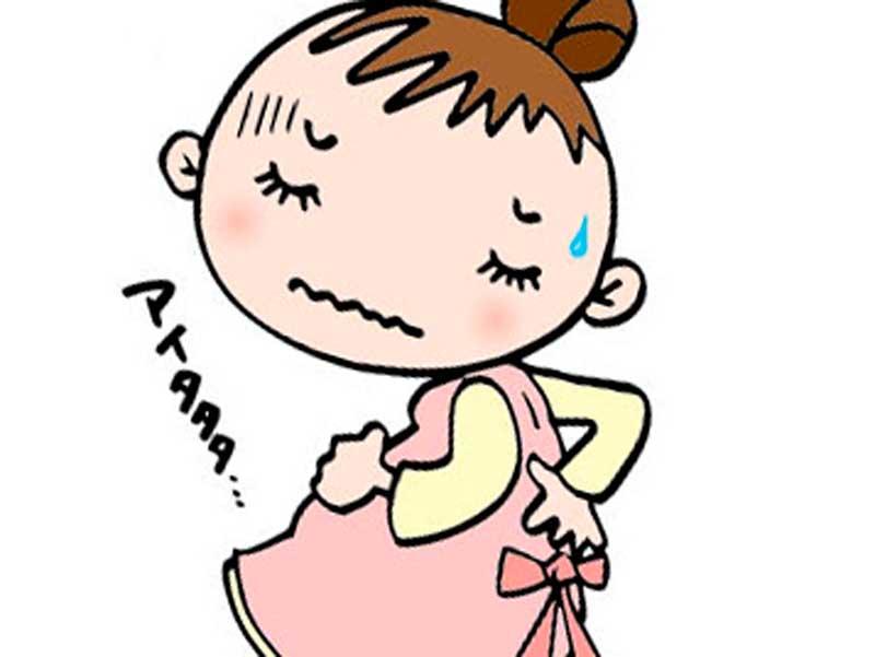 腰痛で腰をおさえている妊婦さんのイラスト