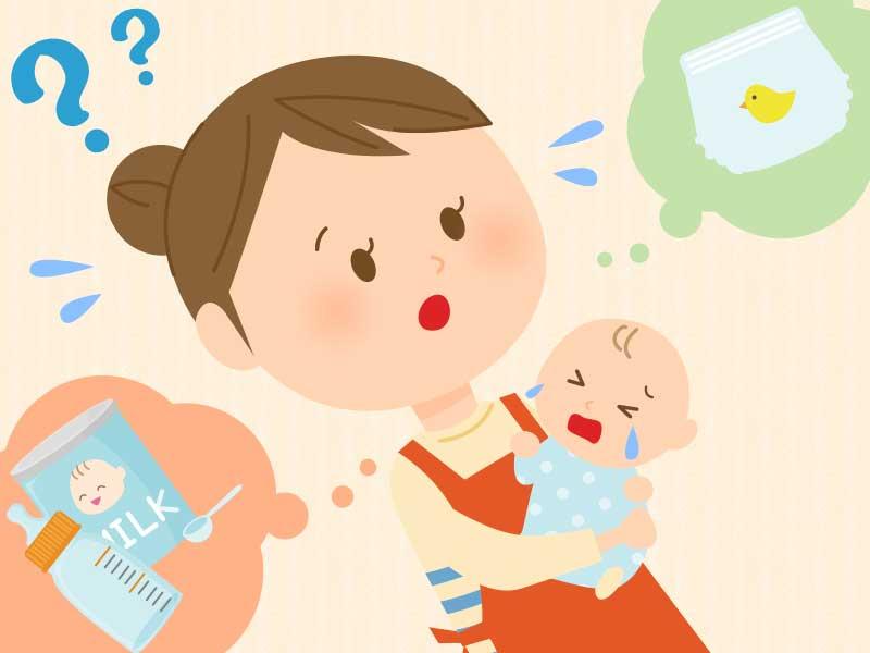 泣いてる赤ちゃんを抱っこしながらミルクかオムツか悩んでいるママ