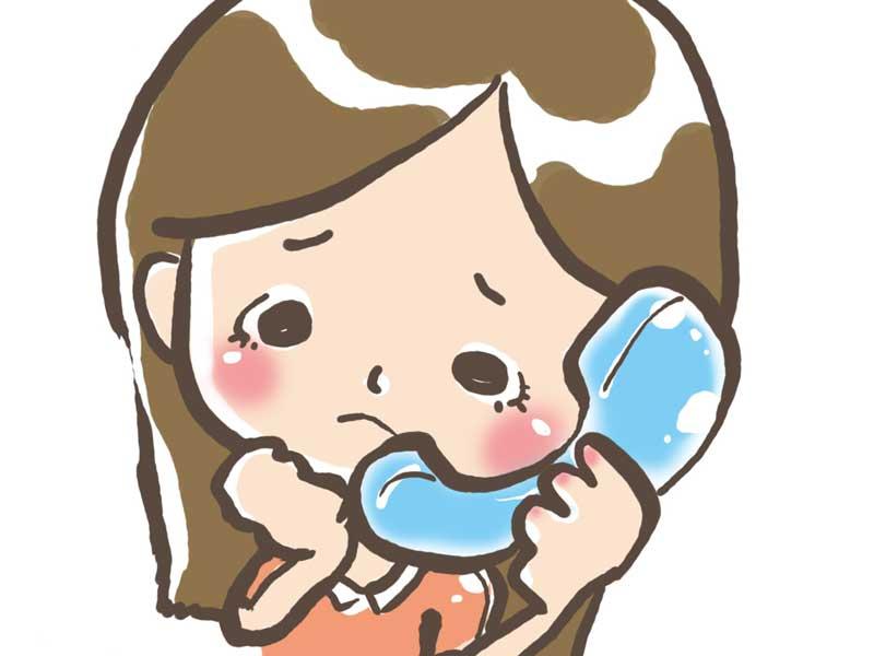病院に電話する妊婦さんのイラスト