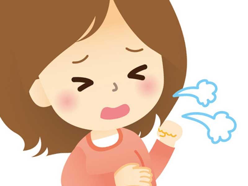 咳をしている妊婦さんのイラスト