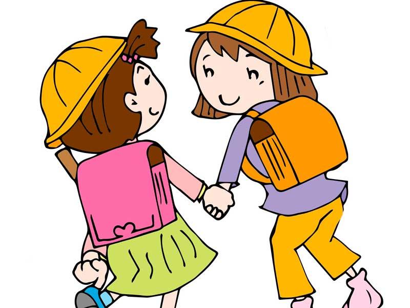 手を繋いで仲良く登校している女の子たちのイラスト