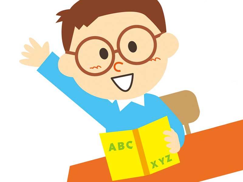 メガネを掛けて勉強をしている子供のイラスト