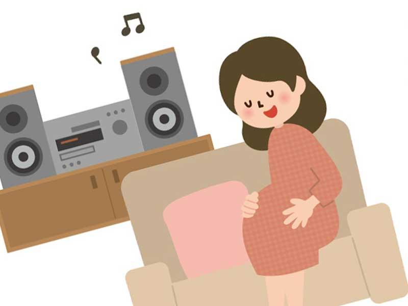 音楽を聴いている妊婦さんのイラスト
