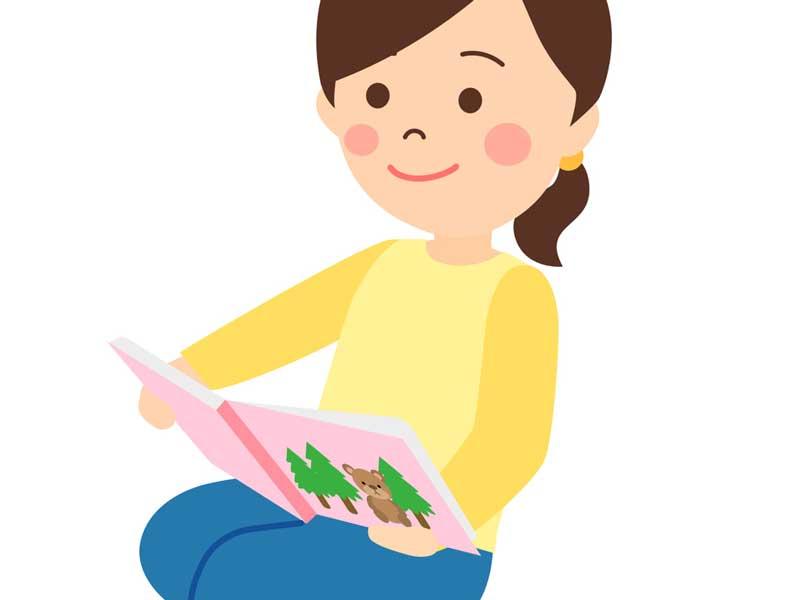 お腹の赤ちゃんに絵本を読み聞かせている妊婦さんのイラスト