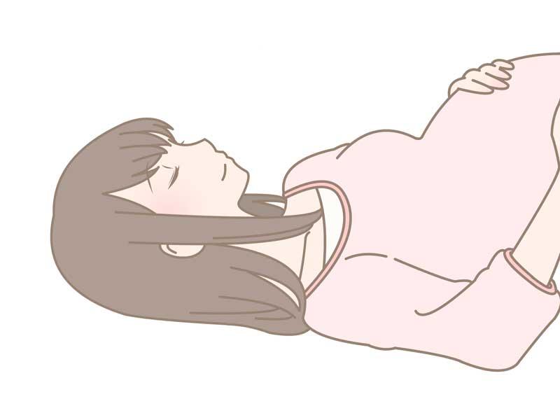 仰向けになっている妊婦さんのイラスト