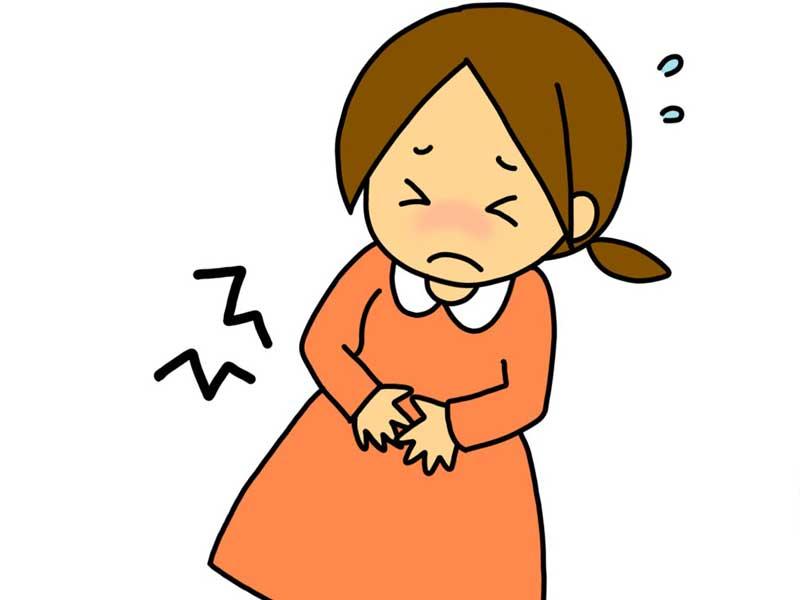 胃痛でおなかをおさえている妊婦さんのイラスト