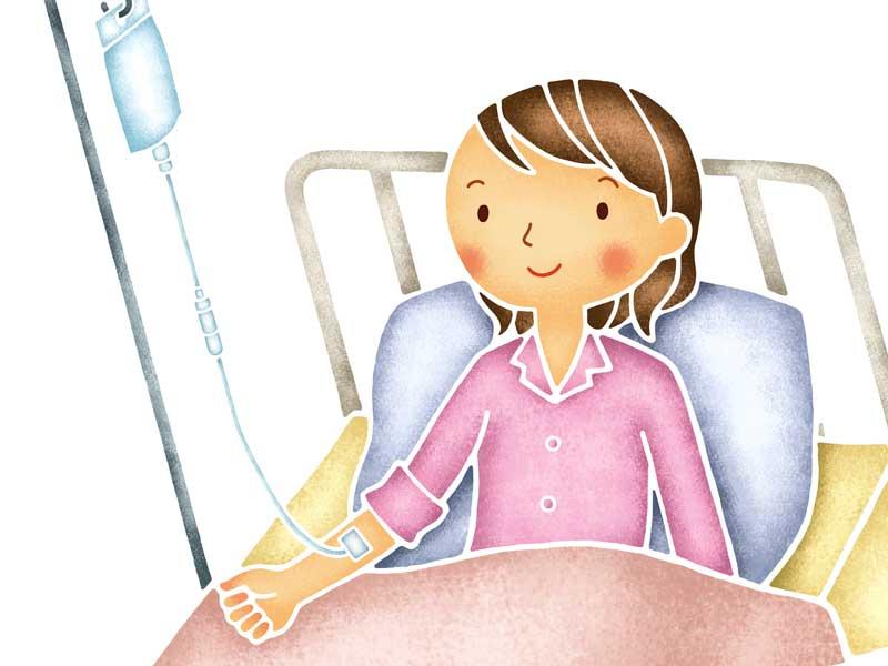 入院中に点滴をしている妊婦さんのイラスト