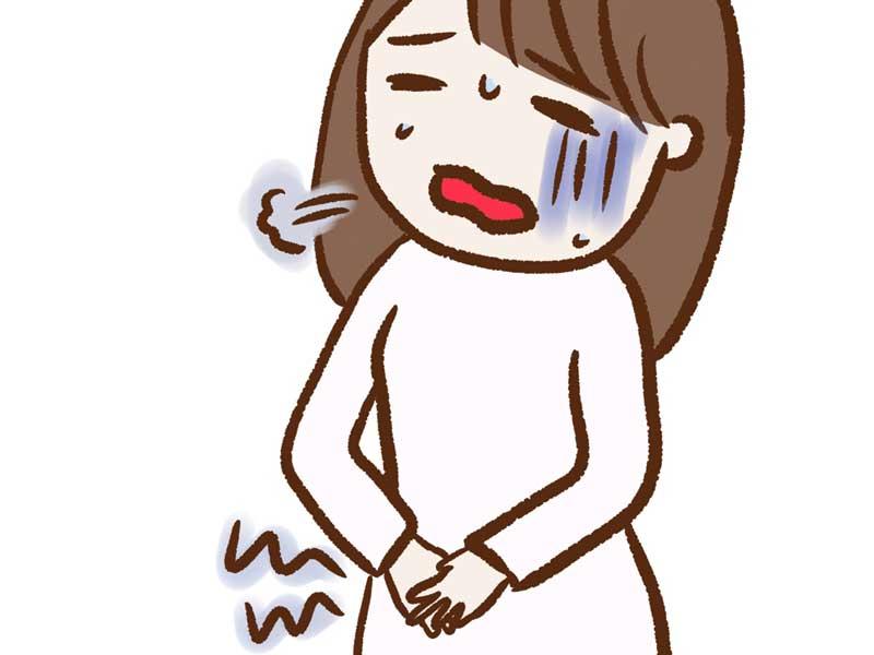 月経でおなかを痛がる女性のイラスト