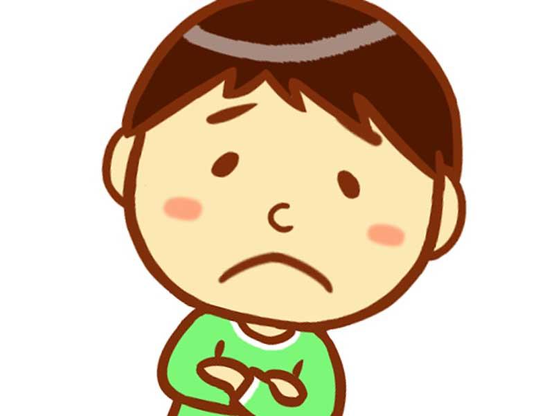 悲しそうな顔をしている子供のイラスト