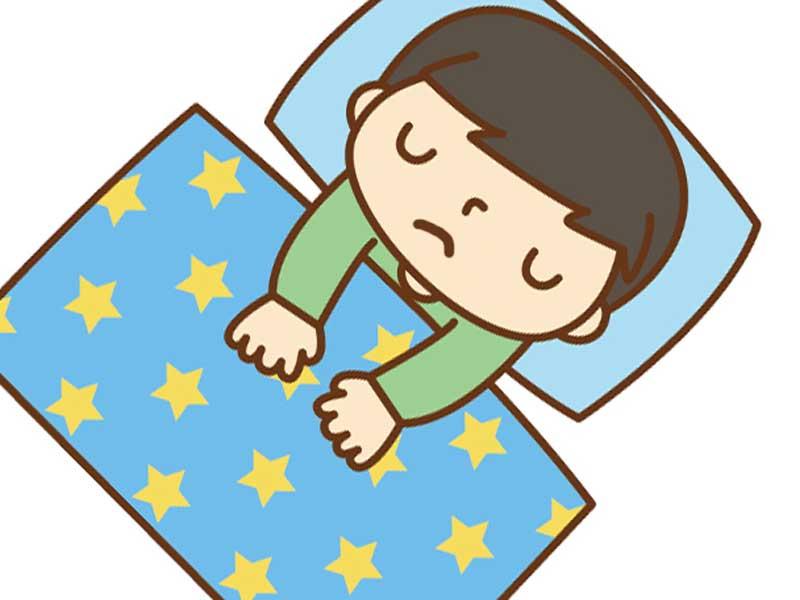学校を休んで寝ている子供のイラスト