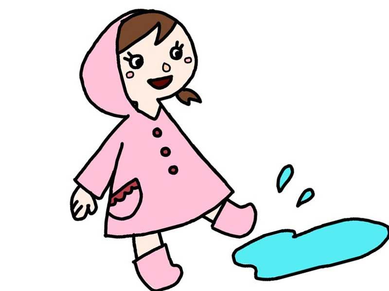 長靴を履いて水たまりで遊んでいる子供のイラスト
