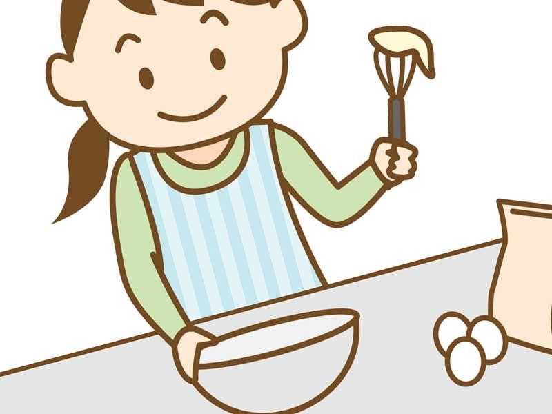 卵で料理をする女の人