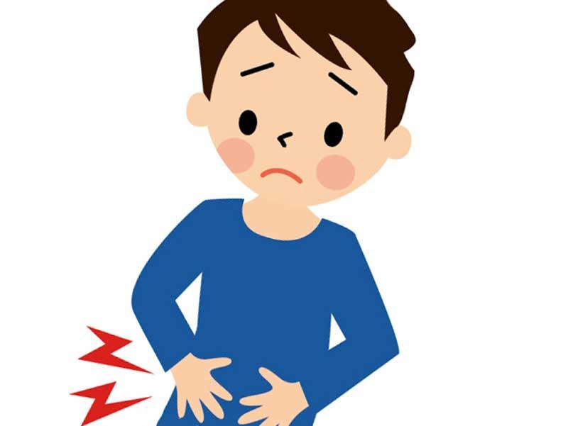 下腹部を痛がっている男の子のイラスト