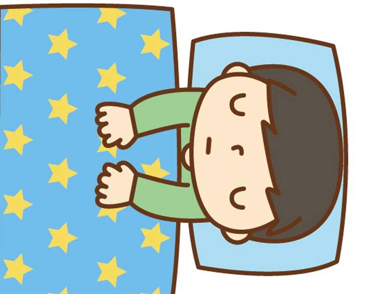 学校を休んで寝ている男の子のイラスト