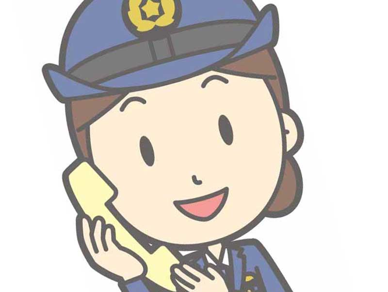 電話を掛けている婦警さんのイラスト