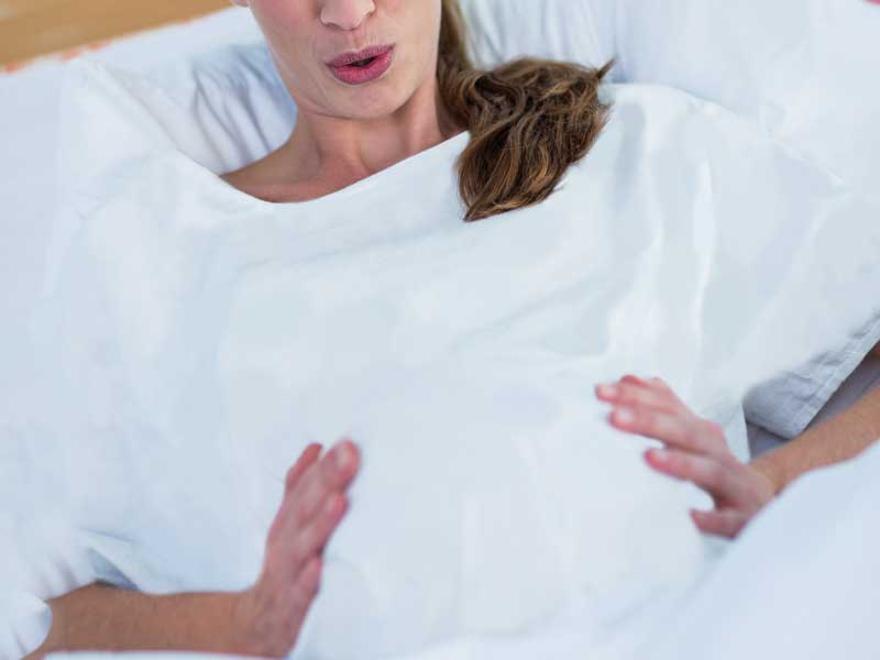 陣痛の激しい妊婦さん
