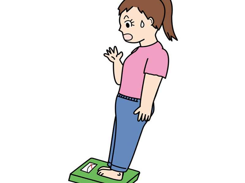 体重計に乗ってビックリしている妊婦さんのイラスト