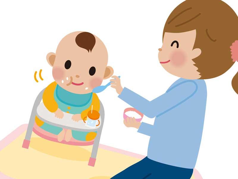 離乳食を食べている赤ちゃんのイラスト