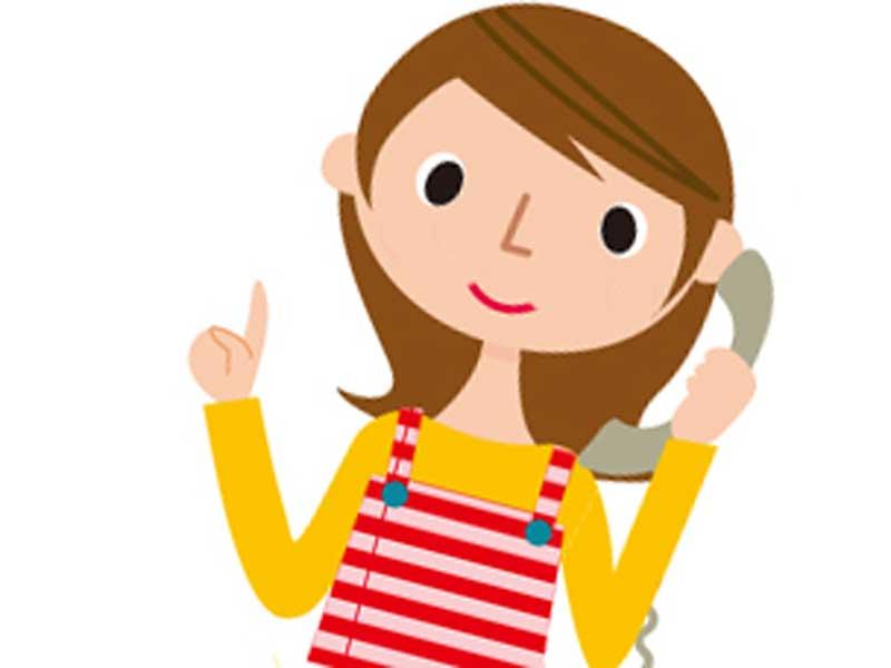 電話を掛ける妊婦さんのイラスト