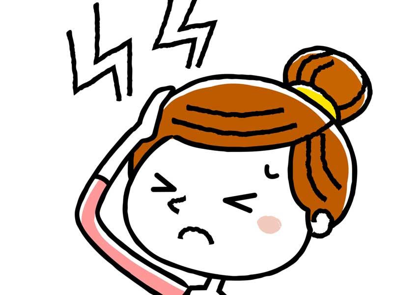 頭痛で頭をおさえている妊婦さんのイラスト