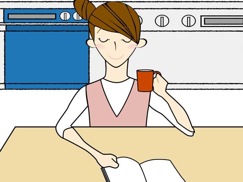 圧力鍋の取扱説明書を読む主婦のイラスト