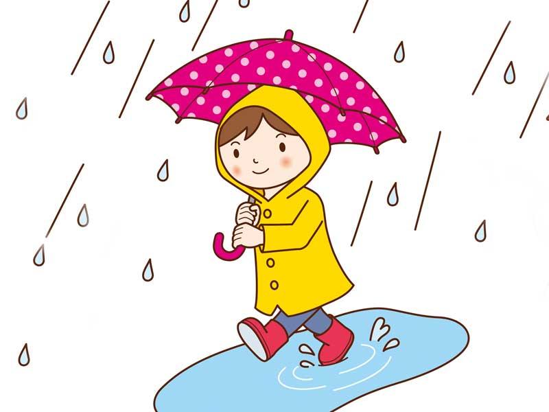 雨の中に傘をさしながら歩く子供のイラスト