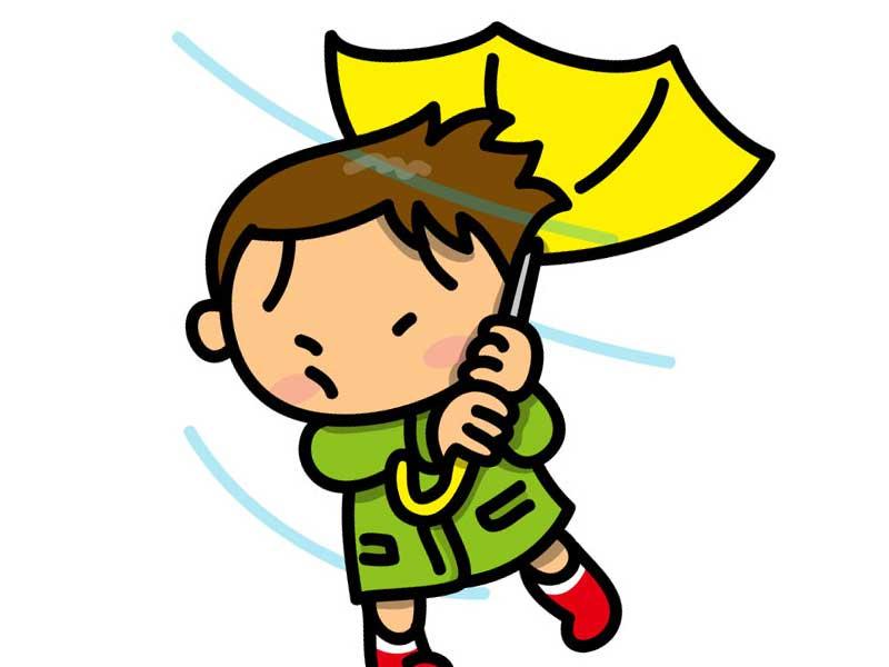 風で壊れている傘と男の子のイラスト